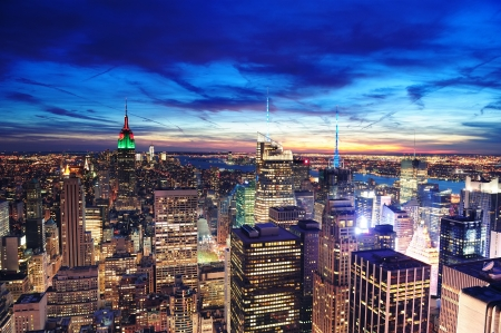 New York City skyline aerial view at dusk with colorful cloud, Empire State and skyscrapers of midtown Manhattan.