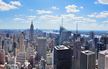 New York City Manhattan midtown aerial panorama view with skyscrapers and blue sky in the day