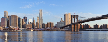 Brooklyn Bridge with lower Manhattan skyline panorama in the morning with cloud and river re