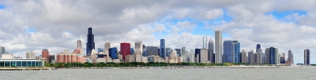 Chicago skyline panorama with skyscrapers over Lake Michigan with cloudy blue sky