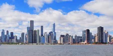 Chicago city urban skyline panorama with skyscrapers over Lake Michigan with cloudy blue sky
