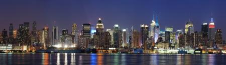 New York City Manhattan midtown skyline panorama at dusk with historical landmark skyscraper