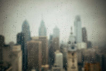 Philadelphia city rooftop view with urban skyscrapers in a raining day.の写真素材