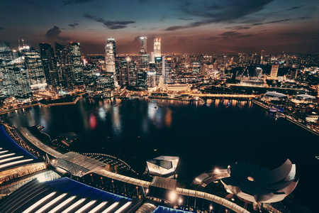 Photo for Singapore Marina Bay rooftop view with urban skyscrapers at night. - Royalty Free Image