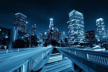 Photo pour Los Angeles downtown at night with urban buildings and light trail - image libre de droit