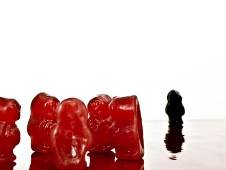 Group of red jelly- with isolated black jelly-, depicting discrimination