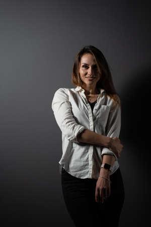 Photo pour Business woman portrait on black background. Confident model posing. Lifestyle - image libre de droit