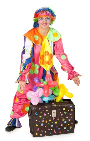Clown with carpetbag and inflatable flowers on white background