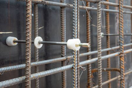 Photo pour Plastic tie rod cone & Water Stopper (Rubber Ring) of form tie system  for concrete wall formwork in construction site, Form Tie Accessories System for Reinforced  Wall Concrete Building Construction. - image libre de droit