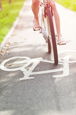 Blurred woman riding bicycle on a bike path