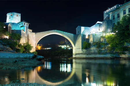 Old stone bridge across Neretva in Mostar at night