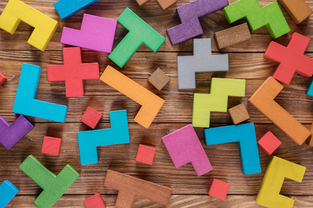 Foto de Abstract background with different colorful shapes wooden blocks. Geometric shapes in different colors. Concept of creative, logical thinking. - Imagen libre de derechos