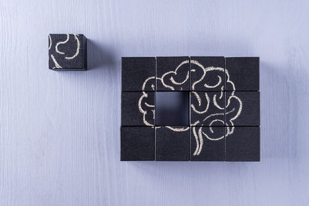 Photo for The concept of the human brain. Education, science and medical concept.  Brain drawn in chalk on black cubes. - Royalty Free Image