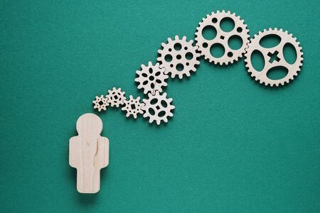 Photo pour Abstract man with gears on gray background - concepts of business,  functioning, efficiency, interlocking parts. - image libre de droit