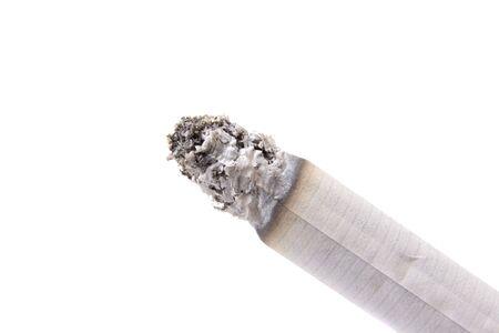 Burning cigarette on white ground