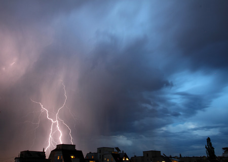 Thunderstorm lights. Bright lightning thunderstorms sparkle from the cloud. Dangerous electrical flash. Levin or scintillation for weather concept. Storm weather with heavy rain. Lightning bolt strikes with color clouds on the sky.