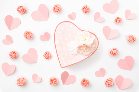 Photo for Valentine's day greeting card with decorated paper heart coral or pink rose flowers and  heart shape coral gift box isolated on white background. Top view. Flat lay. - Royalty Free Image