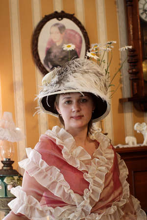 The woman in historical clothing, indoor, Russia