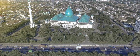 Banner website of Surabaya Mosque with Busy Traffic