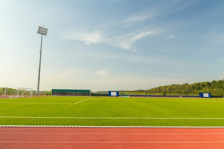 Empty Stadium Arena With Football Field And Racing Tracks