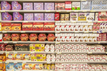 Supermarket Shelves Full With Different Candy Boxes