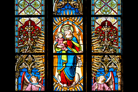 CLUJ NAPOCA, ROMANIA - AUGUST 21, 2014: Baby Jesus And Virgin Mary Stained Glass Window Inside The Gothic Roman Catholic Church of Saint Michael Built In 1390.