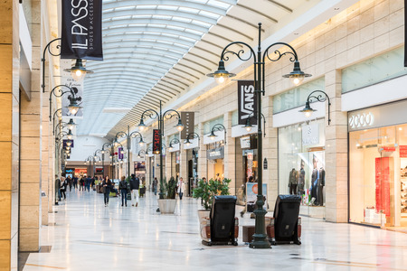 BUCHAREST, ROMANIA - JANUARY 27, 2015: People Shopping In Luxury Shopping Mall Interior.
