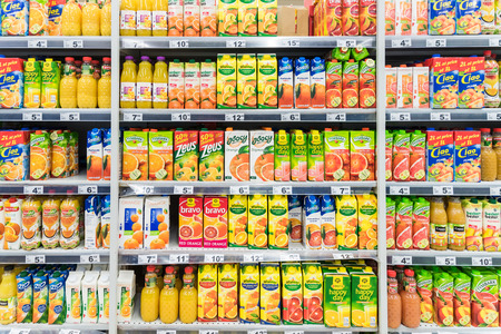 BUCHAREST, ROMANIA - MARCH 15, 2015: Orange Soda Juice Bottles On Supermarket Stand.