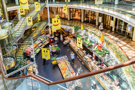 VIENNA, AUSTRIA - AUGUST 08, 2015: People Shopping For Grocery Food In Supermarket Store Aisle.