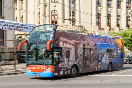 BUCHAREST, ROMANIA - MAY 11, 2016: Bucharest City Tour Bus offers tourists visiting Bucharest a complete tour of the most important landmarks in the city.