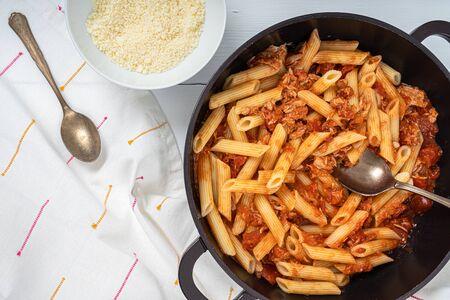 Foto de Tomato And Tuna Fish Penne Pasta With Parmesan - Imagen libre de derechos