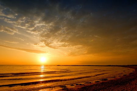 sun rise sea landscape with golden sea and clouds on sky