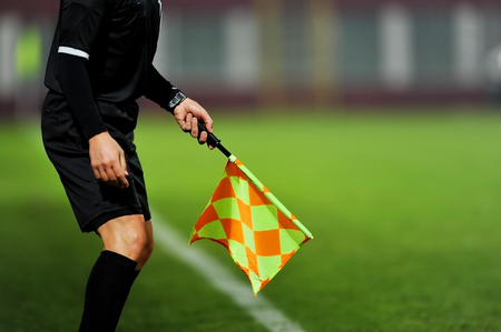 Assistant referees in action during a soccer match