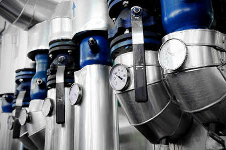 Photo pour Industrial shot with a manometers and heating pipelines inside a water heating station - image libre de droit