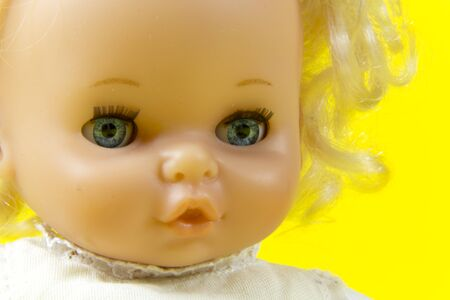 vintage doll, dolly, puppet, old toy, retro, yellow background, blue eyes, blond hair, infant, infantile, childish