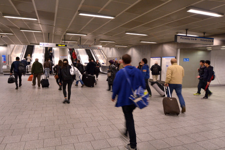 LONDON, UK - MAY 15 2015:Passengers travel in  London Underground station. An average of 2.7 million tube journeys are made on the tube each and every day.