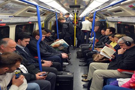 LONDON, UK - MAY 15 2015:Passengers travel on  London Underground. The Annual passenger numbers of london Underground  is 1.265 billion