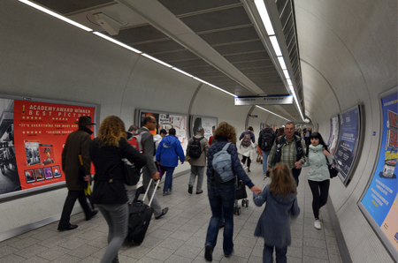 LONDON, UK - MAY 15 2015:Passengers travel in  London Underground station. The busiest station is Victoria, with 76.5 million passengers a year.