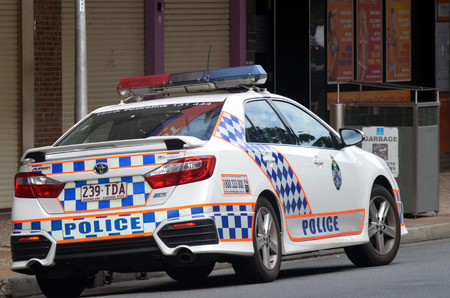 BRISBANE, AUS - SEP 25 2014:Queensland Police car patrol.Gold Coast police on high terror alert warned to be hyper vigilant and patrol local mosques and critical infrastructure sites