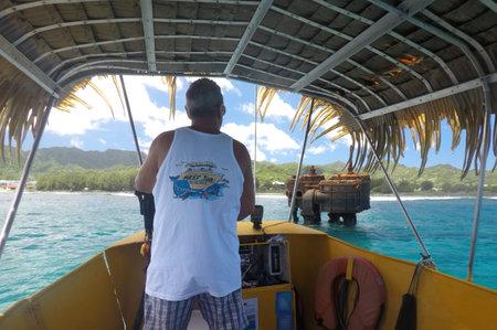 RAROTONGA - DEC 28 2018:Skipper sail the Raro Reef Sub Marine Life Eco Tours to RMS Maitai. The Yellow submarine explore the outer reef underwater marine life of Avarua harbour in Rarotonga, Cook Islands.