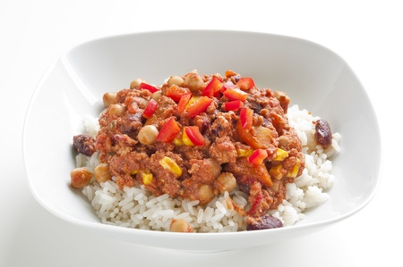 Rice with chili con carne and red chili peppers