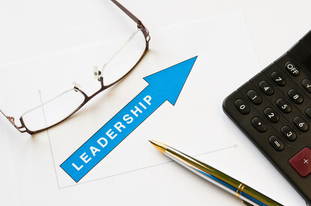 Leadership concept - arrow pointing up graph printed on white paper