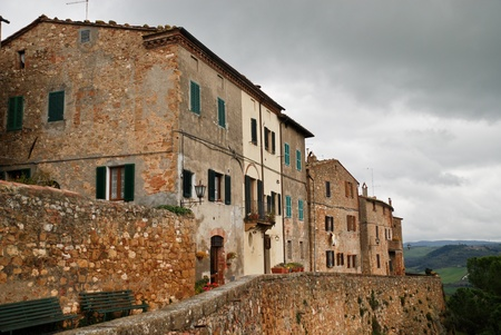 street and wall of a traditional italian village in Pienza, Tuscany in Italy