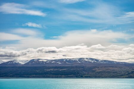 Photo for Beautiful view of the bluish Pukaki Lake with snowy Mount Cook in the background, New Zealand - Royalty Free Image