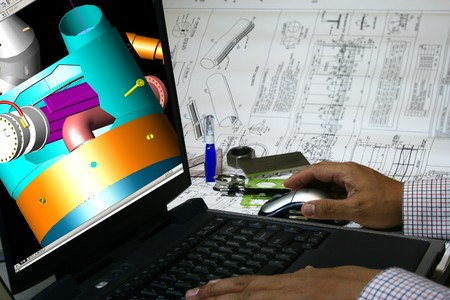 Mechanical engineer designing a pressure vessel. Note 3d display in the monitor is my original works.