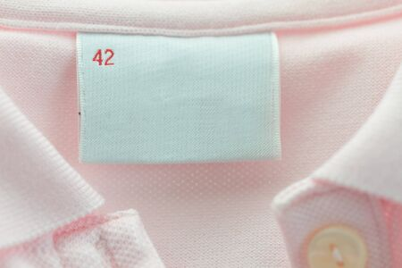 Blank label of a pink clothing with 42 size