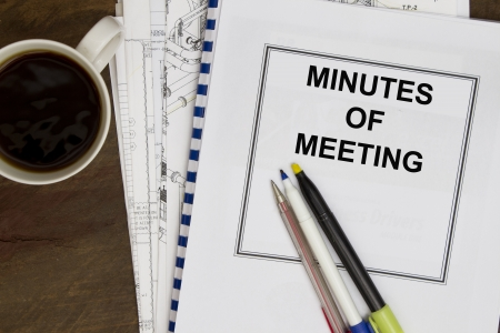 Minutes of meeting with coffee and engineering drawing
