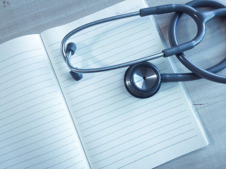 Photo pour close up stethoscopes for doctor working or education with copy spaceon desk table - image libre de droit