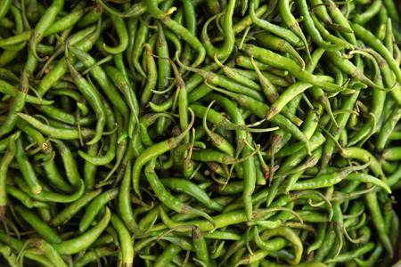 green chili peppers in the market on india