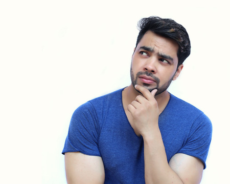 Photo for Young Indian Confused Man Scratching His Chin - isolated white background - Royalty Free Image